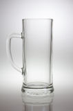 Empty beer mug. With a big handle close up in backlight Stock Photography