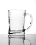 Empty beer mug with drops. Empty beer mug close up over white background Royalty Free Stock Images