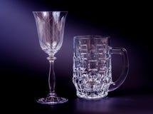 Beer mug and wine glass. Empty beer mug and wine glass on black Stock Photography