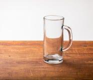 Empty beer mug on wood Stock Photo
