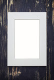 Empty beige frame on dark wooden desk Stock Photos