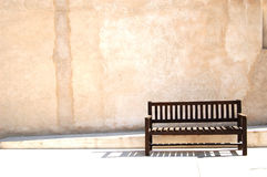 Empty bench. An empty bench along the street Stock Image