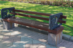 Empty bench in the alley in the park Royalty Free Stock Image