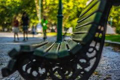 empty bench in avenida de liberdade with  a beautiful  bokeh in the background.  date  2 July  2019. stock images