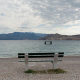 Empty bench on the beach Royalty Free Stock Photography