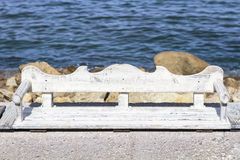 Empty bench at the beach Stock Photography