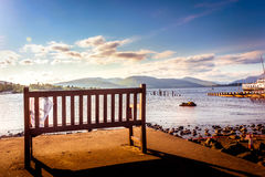 Empty bench and beautiful landscape view of Loch Lomond in Scotl Stock Images