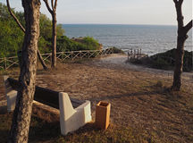 Empty bench on a beautiful sea wiew in golden evening light Royalty Free Stock Photo