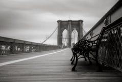 Empty Bench on Brooklyn Bridge in New York City Stock Photo