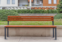 Empty bench on the city street. Close royalty free stock image