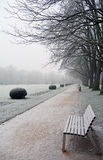 Empty bench in covered hoar-frost park a winter day Stock Photo
