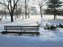 An empty bench covered by snow royalty free stock photos