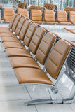 Empty bench in departure flights waiting hall. Stock Image