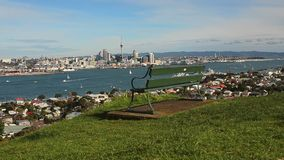 Empty bench facing Auckland skyline Royalty Free Stock Image