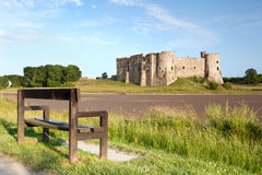 Empty bench facing Carew Castle, Pembrokeshire, Wales Stock Photos