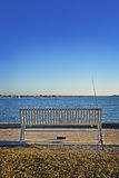 Empty Bench & Fishing Pole Royalty Free Stock Photos