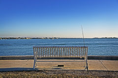 Empty Bench & Fishing Pole Stock Photography