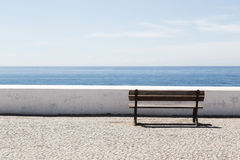 Empty bench in front of the Atlantic Ocean Royalty Free Stock Image
