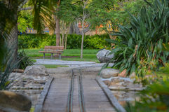 Empty bench and kids train track in Largo Central Park in Largo, Florida, USA. Empty bench and kids train track in Largo Central Park, Largo, Florida, USA royalty free stock image