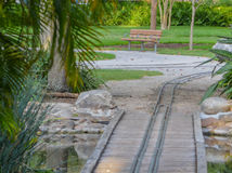 Empty bench and kids train track in Largo Central Park in Largo, Florida, USA. Empty bench and kids train track in Largo Central Park, Largo, Florida, USA stock photo