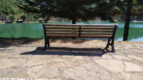 Empty bench with lake view. Sightseeing view outdoor footage stock video footage