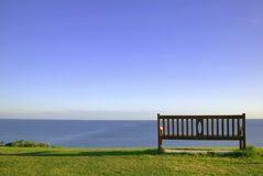 Empty bench looking to sea. Royalty Free Stock Images