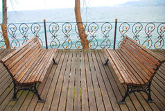 Empty bench looking to sea. Stock Photography
