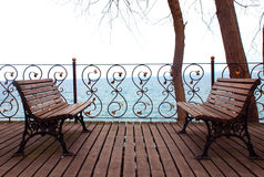 Empty bench looking to sea. Stock Photos