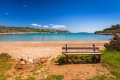 Empty bench at Marathi bay beach on Crete. Greece royalty free stock images