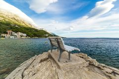 Empty bench by the mediterranean sea, landscape Stock Photo