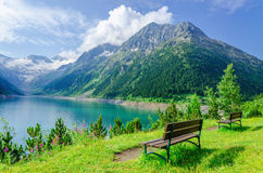 Empty bench and mountain lake, Zillertal, Austria Stock Image