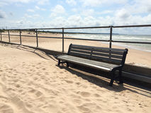 Empty bench near the Baltic sea Stock Photos