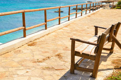 Empty bench overlooking the sea. Empty bench on the viewing platform overlooking the sea Stock Image