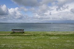 Empty bench overlooking Solent Stock Photo