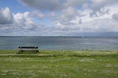Empty bench overlooking Solent Stock Photo