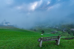 Empty bench overlooking Sorica village in Slovenia.  royalty free stock photo