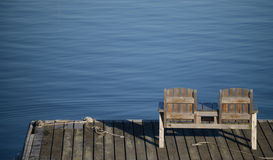 Empty bench overlooking the water in a relaxing scene Stock Image