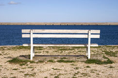 Empty bench at the pier Royalty Free Stock Photo