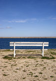 Empty bench at the pier Stock Photo