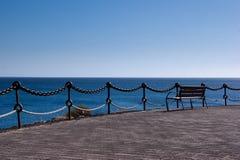Empty bench in playa  blanca, lanzarote. Empty bench in playa blanca overlooking fuerteventura Royalty Free Stock Photo