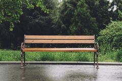 Empty bench with rain drops Stock Photography