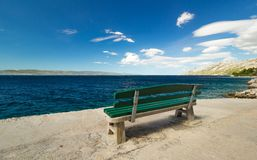 Empty bench by the sea, beautiful landscape Stock Image