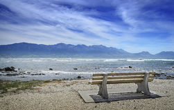 Empty bench on the seafront. Royalty Free Stock Photo