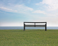 Empty bench at seaside Stock Photo