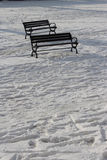 Empty bench on the snow Stock Photography