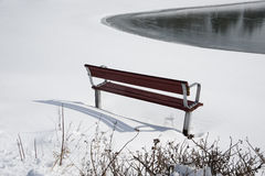 Empty bench in the snow Royalty Free Stock Photo