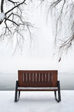 Empty bench in the snow, West Lake, Hangzhou royalty free stock photography