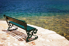 Empty bench on the stone embankment Royalty Free Stock Images