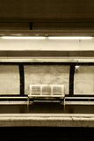 Empty bench in the subway, sepia hue Royalty Free Stock Image