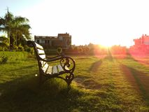 Empty Bench. Sun sets at its adorable beauty Royalty Free Stock Photos